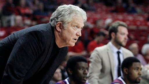 Northwestern State's Mike McConathy watches the game from the bench during the first half of Tuesday's game at Arkansas.