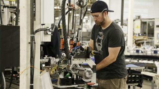 Denny Langworthy assembles part of a power steering column at Nexteer Automotive in Saginaw.