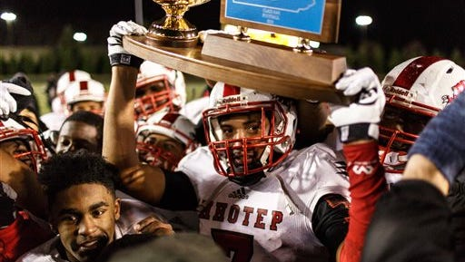 Imhotep Charter celebrates its win over Erie Cathedral Prep in the PIAA Class AAA championship football game Friday
