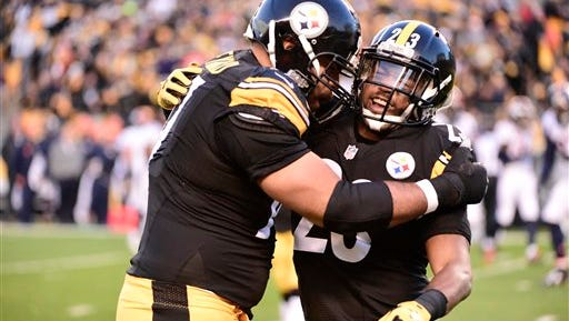 Pittsburgh Steelers free safety Mike Mitchell (23) is greeted by a teammate after recovering a fumble on Sunday vs. Denver.