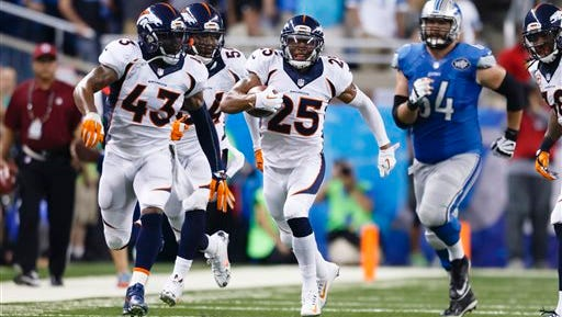 FILE - In this Sept. 27, 2015 file photo, Denver Broncos cornerback Chris Harris (25) runs the ball after a blocked extra point attempt against the Detroit Lions during an NFL football game at Ford Field in Detroit. Denver's defense, which finished No. 1 overall for the first time in franchise history and led the league in sacks, total yards and passing yards, is what will likely determine the Broncos' playoff fortunes. (AP Photo/Rick Osentoski, File)