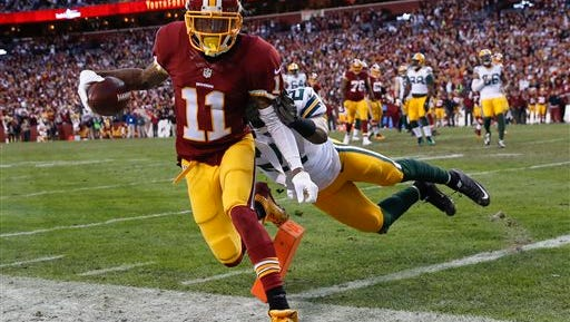 Washington wide receiver DeSean Jackson (11) is knocked out of bounds just short of the end zone by Green Bay Packers free safety Ha Ha Clinton-Dix.
