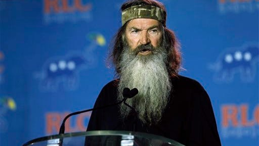 "In this photo taken May 29, 2014, Phil Robertson speaks in New Orleans, La.  Republican presidential candidate, Sen. Ted Cruz, T-Texas, has bagged the endorsement of ""Duck Dynasty"" star Phil Robertson after going hunting with him."