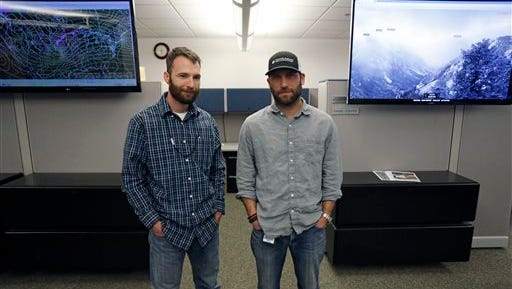 Avalanche forecasters Spencer Logan, left, and Mike Cooperstein pose for a picture at their office at the Colorado Avalanche Information Center, within the offices of the National Weather Service, in Boulder, Colo., Monday Jan. 25, 2016. Ten people have died in avalanches across the West in the last 10 days, making this month the deadliest January for slides in nearly 20 years. (AP Photo/Brennan Linsley)