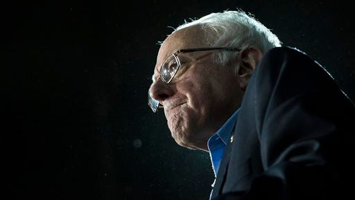 Democratic presidential candidate Sen. Bernie Sanders, I-Vt., grimaces as he delivers his stump speech during a campaign stop at the University of New Hampshire Whittemore Center Arena, Monday, Feb. 8, 2016, in Durham, N.H. (AP Photo/John Minchillo)