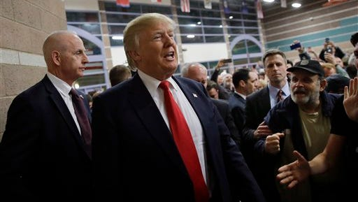 Republican presidential candidate Donald Trump visits a caucus site, Tuesday, Feb. 23, 2016, in Las Vegas.
