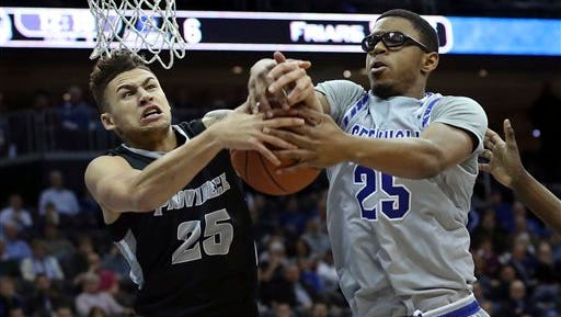 Providence guard Drew Edwards (25) and Seton Hall forward Rashed Anthony (25) grab for the ball.