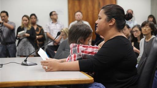 Renee Kewalo speaks against a bill that would have sped up the process for the Hawaii Department of Health to adopt federal vaccination guidelines during a committee hearing Thursday, Feb. 4, 2016, at the Hawaii State Capitol in Honolulu. (AP Photo/Marina Riker)