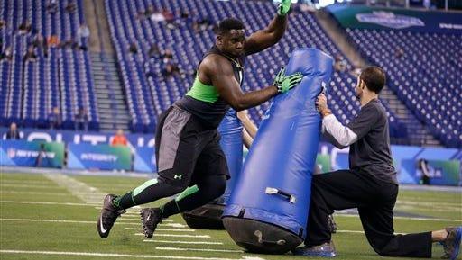 Louisiana Tech defensive lineman Vernon Butler runs a drill at the NFL football scouting combine in Indianapolis, Sunday, Feb. 28, 2016. (AP Photo/Michael Conroy)