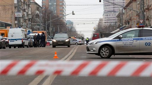 Police and the Investigative Committee secure an area abound a subway station in Moscow on Monday, Feb. 29, 2016, after the arrest of a woman who was waving the severed head of a small child outside the station.