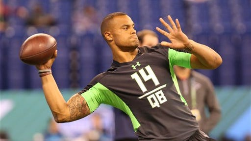 Mississippi State quarterback Dak Prescott performs a drill at the NFL football scouting combine Saturday, Feb. 27, 2016.