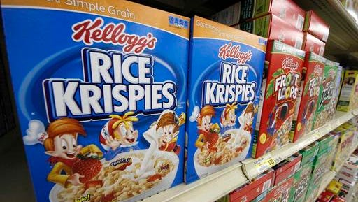 In a Wednesday, July 18, 2012, file photo, Kellogg's cereals are on display at a Pittsburgh grocery market. Kellogg says a criminal investigation is underway after a video surfaced online showing a man urinating on one of its factory assembly lines. The company says it learned of the video Friday, March 11, 2016, and immediately alerted authorities. It says the criminal investigation is being conducted by the U.S. Food and Drug Administration. Kellogg said its own investigation determined the video was recorded at its Memphis, Tenn., factory in 2014.
