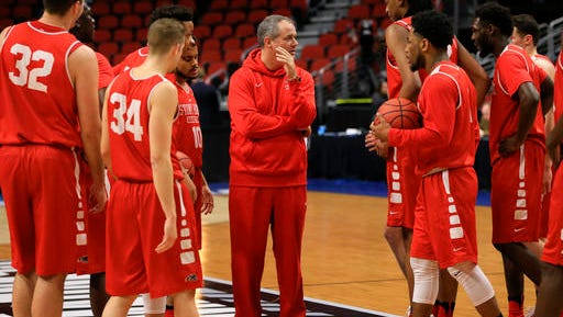Stony Brook coach Steve Pikiell, center, gathers his players during practice ahead of a first-round men's college basketball game in the NCAA Tournament.