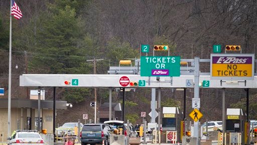 Police investigate at exit 180 off of the Pennsylvania Turnpike where a toll booth worker at the Fort Littleton Exchange was shot early Sunday, March 20, 2016 in an apparent robbery attempt. Authorities say a turnpike employee and another worker were shot and killed in the robbery attempt. The suspect in the shooting was also killed. (Daniel Zampogna/PennLive.com via AP)