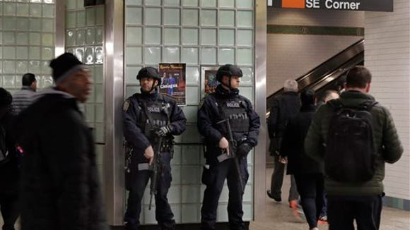 New York City Police Transit officers patrol in New York the subway station in Times Square,  Tuesday, March 22, 2016.