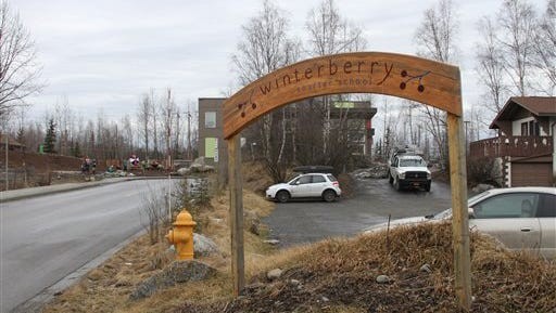 Children play outside Winterberry Charter School in Anchorage, Alaska, Wednesday, March 30, 2016. Three first-graders in Alaska's largest city plotted to kill a fellow student with silica gel packets that the girls believed was poison and have been disciplined but not charged with any crime, authorities said Wednesday.
