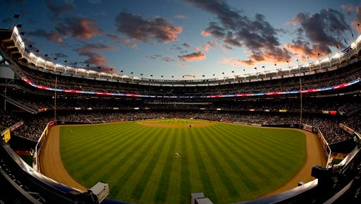The Tampa Bay Rays and the New York Yankees play in the second inning of a baseball game, Tuesday, April 28, 2015, at Yankee Stadium in New York.