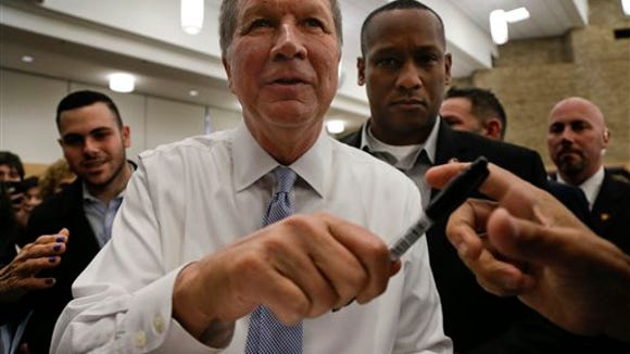 Republican presidential candidate, Ohio Gov. John Kasich hands a pen back to a supporter after signing his autograph during a campaign stop at Hofstra University, Monday, April 4, 2016, in Hempstead, N.Y. (AP Photo/Julie Jacobson)