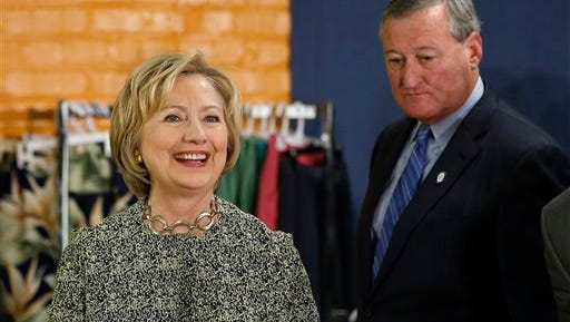 Democratic presidential candidate Hillary Clinton, accompanied by Philadelphia Mayor Jim Kenney, visits Impact Services, Wednesday, April 6, 2016, in Philadelphia.