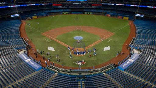 Toronto Blue Jays take to the newly designed field at the Rogers Centre in Toronto, Thursday, April 7, 2016, ahead of their home-opener Friday against Boston Red Sox.