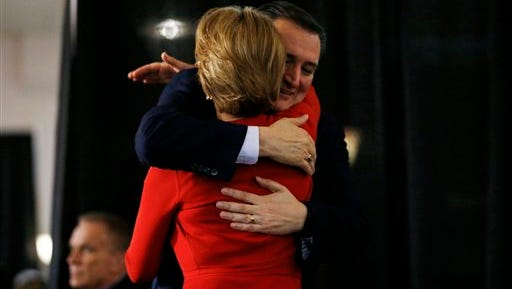 Republican presidential candidate Sen. Ted Cruz, back, R-Texas, hugs Carly Fiorina before speaking during a rally, Wednesday, April 20, 2016, at the Antique Automobile Club of America Museum in Hershey, Pa.