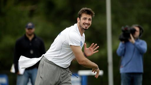 FILE - In this April 6, 2016 file photo, Memphis quarterback Paxton Lynch passes during the school's NFL football pro day, in Memphis, Tenn. A note from a Memphis administrator led Justin Fuente to a quarterback in Florida who taught himself how to throw a football by tossing a baseball. Now Paxton Lynch is poised to become the highest quarterback ever drafted from a university best known for its basketball program.  (AP Photo/Mark Humphrey, File)