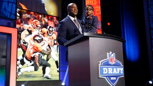 Former Walter Payton Men of the Year DeMarcus Ware announces that the Denver Broncos selects Boston College's Justin Simmons as the 98th pick in the third round of the 2016 NFL football draft, Friday, April 29, 2016, in Chicago. (AP Photo/Charles Rex Arbogast)