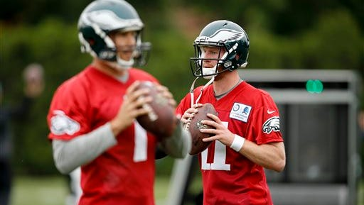 Sam Bradford, left, and Carson Wentz warm up last week during the Eagles' organized team activities.