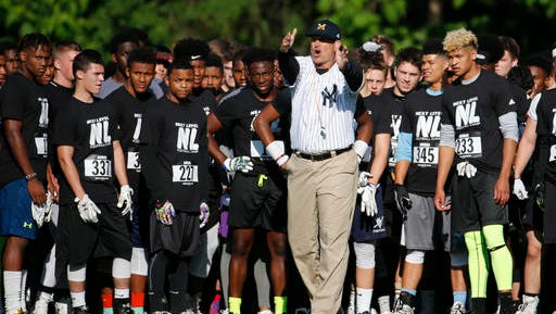 Michigan coach Jim Harbaugh directs campers at the satellite camp hosted by Paramus Catholic simultaneous to a Rutgers football camp.