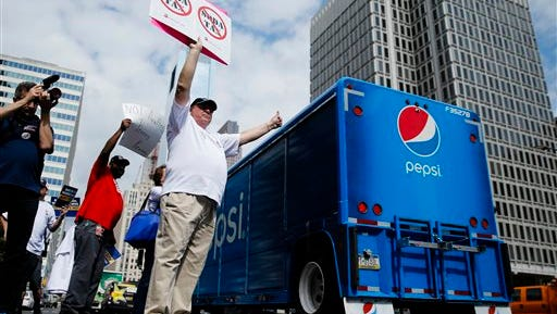 FILE - In this June 8, 2016 file photo, opponents of a proposed sugary drink tax demonstrate outside City Hall in Philadelphia. Philadelphia is set to become the first major American city with a soda tax despite a multimillion-dollar campaign by the beverage industry to block it. The City Council is expected to give final approval Thursday, June 16, 2016, to a 1.5 cent-per-ounce tax on sugary and diet beverages.