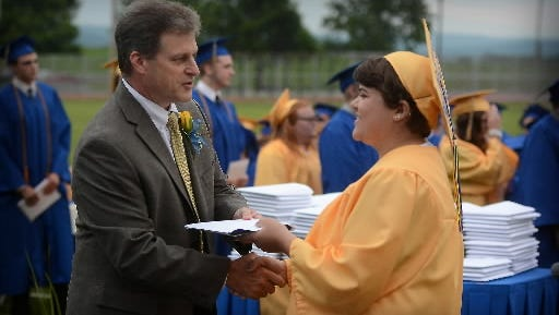 Macey Saphore receives her diploma from Northern Lebanon School District Superintendent Don Bell in this photo taken at the June 3, 2015, commencement ceremony at the Frederick L. Gahres Stadium at Northern Lebanon High School. Bell, who has been with the district since 1999, told the school board this week he would not seek reappointment after his contract expires in 2017.