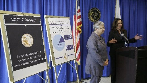 California Attorney General Kamala Harris, right, answers questions about a settlement with Volkswagen as Mary Nichols, left, Chair of the California Air Resources Board, looks on during a news conference Tuesday, June 28, 2016, in San Francisco. Volkswagen will spend up to $15.3 billion to settle consumer lawsuits and government allegations that it cheated on emissions tests in what lawyers are calling the largest auto-related class-action settlement in U.S. history. Up to $10 billion will go to 475,000 VW or Audi diesel owners, who thought they were buying high-performance, environmentally friendly cars but later learned the vehicles' emissions vastly exceeded U.S. pollution laws. (AP Photo/Eric Risberg)
