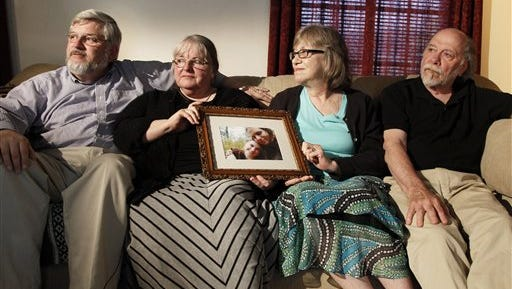 From left, Patrick Boyle, Linda Boyle, Lyn Coleman and Jim Coleman hold a photo of their kidnapped children, Joshua Boyle and Caitlan Coleman, who were taken by the Taliban in late 2012, in this 2014 photo taken in Stewartstown.