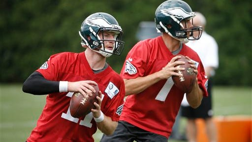 Eagles rookie quarterback Carson Wentz (11) and Sam Bradford (7) work on a passing drill during organized team activities in June.