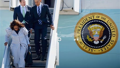 President Barack Obama arrives on Air Force One with Rep. Patrick Murphy, D-Fla., and Rep. Corinne Brown, D-Fla.  at Cecil Airport in Jacksonville, Fla., Friday, Feb. 26, 2016, to visit Saft America factory, which opened in 2011 with help from federal money from economic stimulus package he pushed through Congress in 2009.