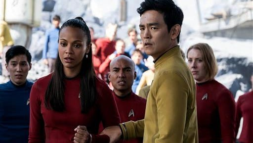 "In this image released by Paramount Pictures, Zoe Saldana, left, as Uhura and John Cho as Sulu appear in a scene from, ""Star Trek Beyond."" The movie releases in the U.S. on July 22, 2016."