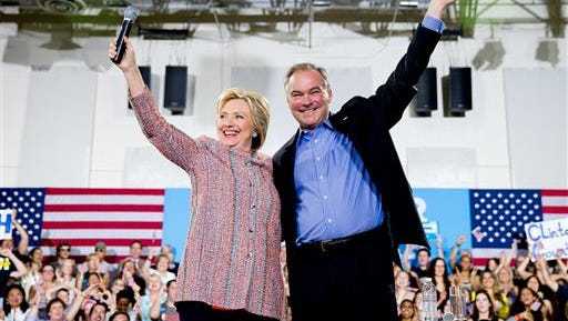 In this July 14, 2016, file photo, Democratic presidential candidate Hillary Clinton, accompanied by Sen. Tim Kaine, D-Va., speaks at a rally at Northern Virginia Community College in Annandale, Va. Kaine has been rumored to be one of Clinton's possible vice president choices.