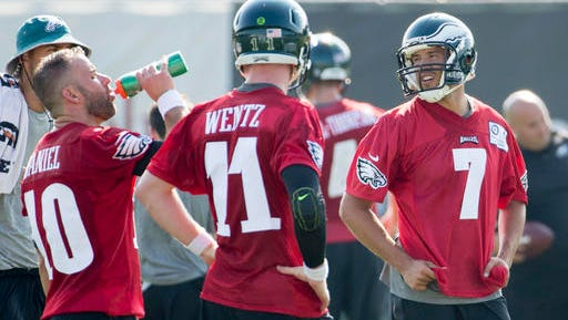 Eagles quarterback Sam Bradford, right, takes a break with Chase Daniel, left, and Carson Wentz, center, during the first day of Eagles' training camp Monday.