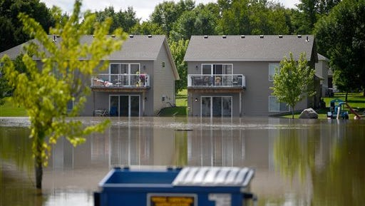 Lower level apartment units on 3rd Ave Southeast are flooded due to last night's storm in Willmar, Minn., Thursday, Aug. 11, 2016.  afternoon. Heavy rain dumped as much as 10 inches of water on parts of Minnesota Wednesday night and Thursday. Some residents of Willmar, in south-central Minnesota, were using kayaks on some city streets and residents were being asked to limit water use. (Aaron Lavinsky/Star Tribune via AP)