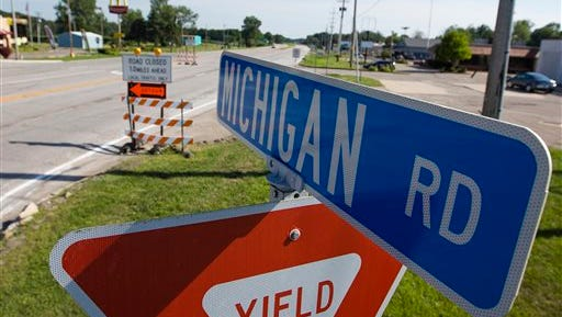 This July 26, 2016 photo shows signs diverting traffic on Michigan Road near the intersection of U.S. 6 in LaPaz, Ind.  A new bypass is part of a broader state project with other bypasses built to improve U.S. 31 from South Bend to Indianapolis, has resulted in a faster drive for motorists. Traffic studies indicate it has rerouted the daily flow of more than 20,000 vehicles from the old route.   (Michael Caterina /South Bend Tribune via AP)