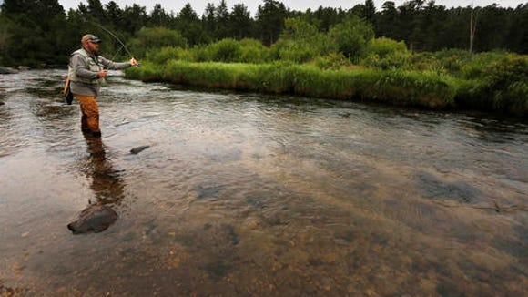 Angler Chris Atkins of Allendale, Mich., fly fishes