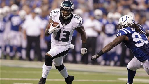 Eagles wide receiver Josh Huff gets past a Colts defender on his way to scoring on a 9-yard run.