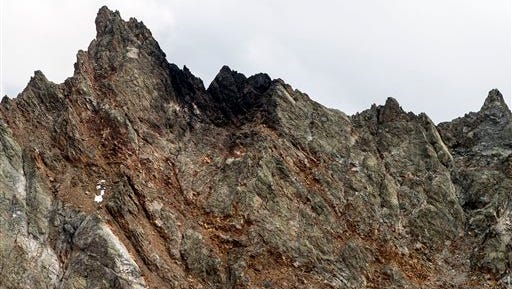 The crash site of the missing F/A-18 jet plane is pictured on the Sustenpass, Switzerland, Wednesday, Aug. 31, 2016. Swiss authorities say the body of a Swiss fighter jet pilot has been found after his U.S.-built F/A-18C aircraft went missing in the Alps two days ago. (Alexandra Wey/Keystone via AP)
