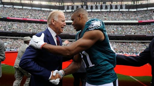Philadelphia Eagles wide receiver Jordan Matthews, right, meets with Vice President Joe Biden before an NFL football game against the Cleveland Browns, Sunday, Sept. 11, 2016, in Philadelphia. (AP Photo/Michael Perez)
