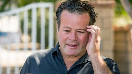 Former NASCAR racer Robby Gordon makes a statement to members of the media gathered outside his home in Orange, Calif., on Thursday, Sept. 15, 2016. Gordon said his family is in shock and grieving the loss of his father and stepmother, who were found dead inside their Southern California home.  (AP Photo/Damian Dovarganes)
