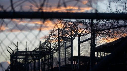 FILE - In this Nov. 21, 2013 file photo reviewed by the U.S. military, dawn arrives at the now closed Camp X-Ray, which was used as the first detention facility for al-Qaida and Taliban militants who were captured after the Sept. 11 attacks, at the Guantanamo Bay Naval Base, Cuba. A recently released transcript from the U.S. base at Guantanamo Bay, Cuba, features new allegations of involvement in terrorism by officials in Saudi Arabia, including an unnamed member of the royal family.  (AP Photo/Charles Dharapak, File)