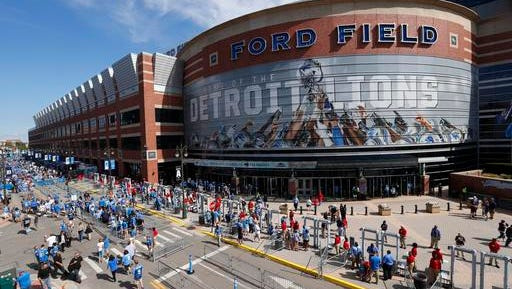 Football fans arrive at Ford Field for an NFL football game between the Detroit Lions and the Tennessee Titans, Sunday, Sept. 18, 2016, in Detroit.