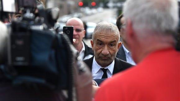 Alain Kaloyeros, president of SUNY Polytechnic Institute leaves Albany City Courthouse following his arraignment on state charges on Friday, Sept. 23, 2016, in Albany, N.Y.   (Will Waldron/The Albany Times Union via AP)