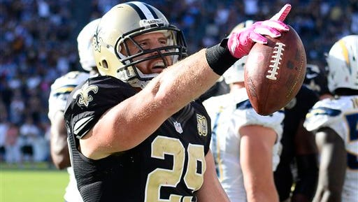 New Orleans Saints fullback John Kuhn gestures to the crowd after scoring a touchdown last year against the San Diego Chargers.