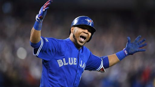 Toronto Blue Jays' Edwin Encarnacion celebrates his walk-off three-run home run during the 11th inning of an American League wild-card baseball game in Toronto, Tuesday, Oct. 4, 2016.
